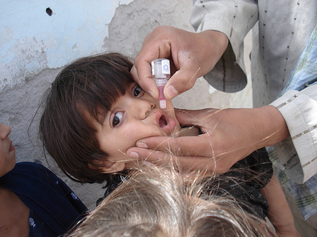A Afghan boy recieves polio vaccination. Image by Canadian International Development Agency/Sharif Azami, via Flickr.