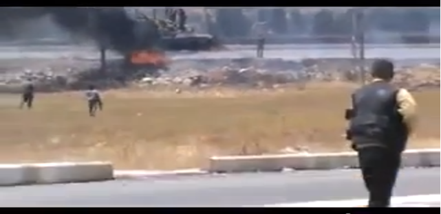 Fighting in Aleppo. Screencap via YouTube.