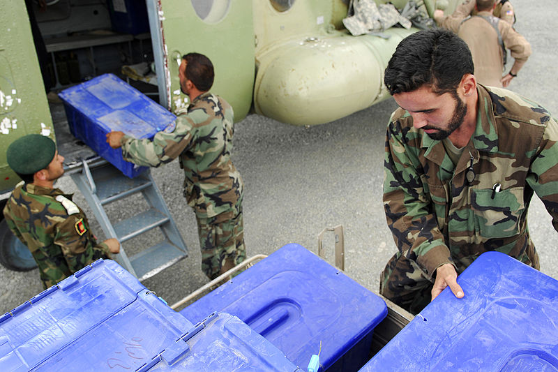 Afghan soldiers unload ballot boxes, 2009. US Air Force photo by Staff Sgt. Thomas Dow, via Wikimedia.