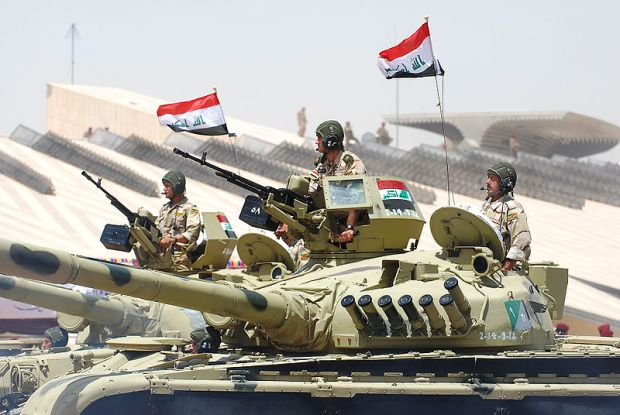 Iraqi tanks on parade in Baghdad, in 2009. US Air Force photo by Tommy Avilucea, via Wikimedia.