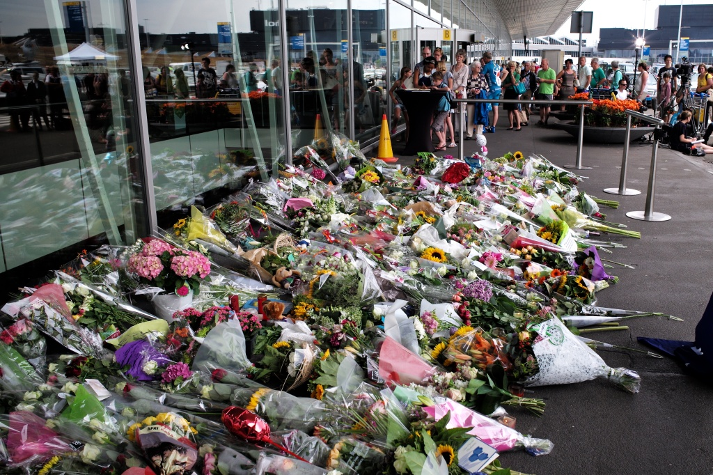 Flowers outside Amsterdam Airport in memory of MH17's passengers and crew. Courtesy of Roman Boed.