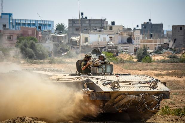 An Israeli tank rolls through Gaza. From the IDF Flickr account.