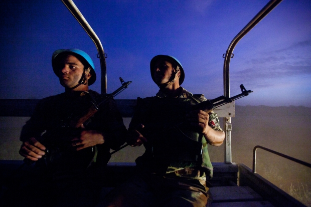Two Egyptian peacekeepers operate at twilight in North Darfur. Via the United Nations.