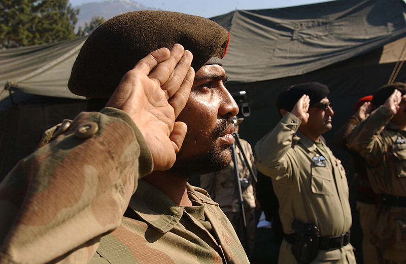 A soldier from the 67th Medical Battalion of the Pakistan Army salutes. Via wikimedia.
