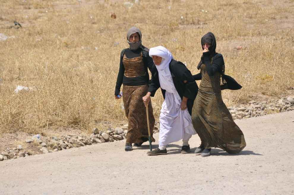 Yazidi women flee ISIS forces in northern Iraq. By Domenico.