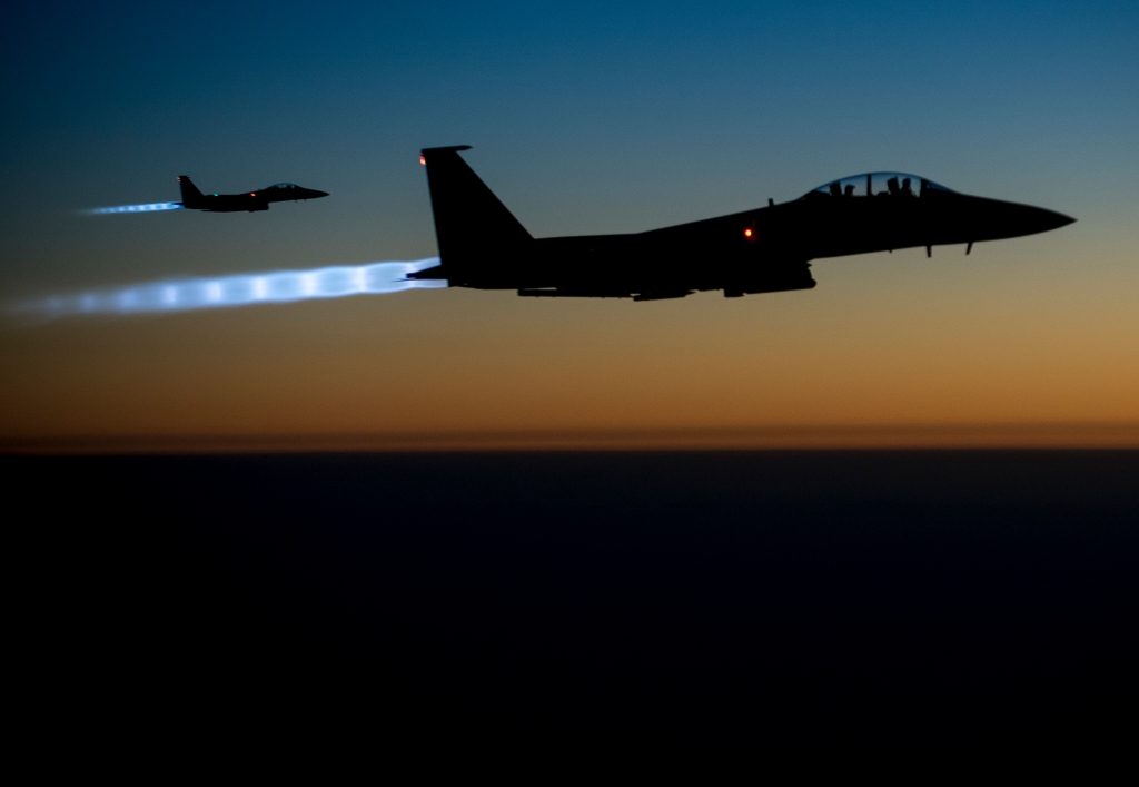 Two U.S. Air Force F-15E Strike Eagle aircraft return after conducting strikes in Syria. By the U.S. Department of Defense.
