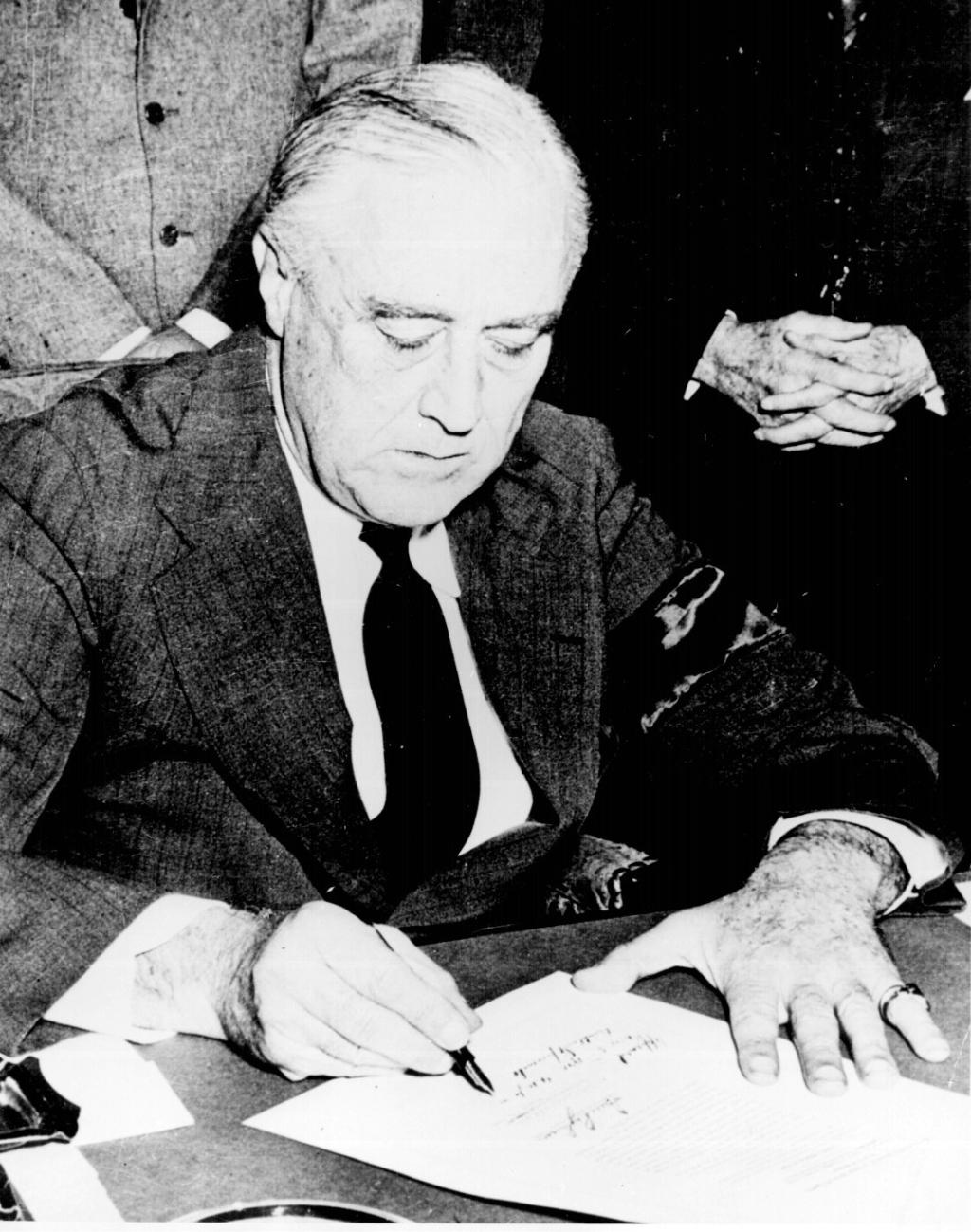 President Franklin D. Roosevelt signing the Declaration of War against Japan, December 8, 1941. By Marion Doss.