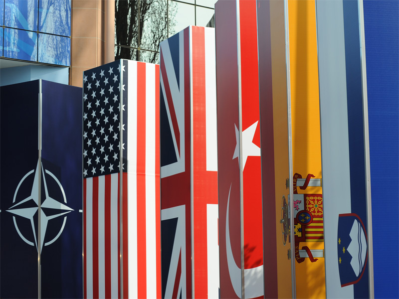 The NATO flag and flags of member-states outside the organization's summit in 2009. By Downing Street.