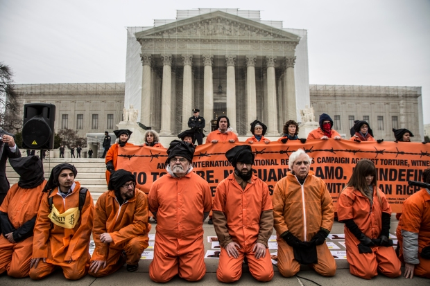 Activists protest the US' use of torture in front of the Supreme Court. By Justin Norman.