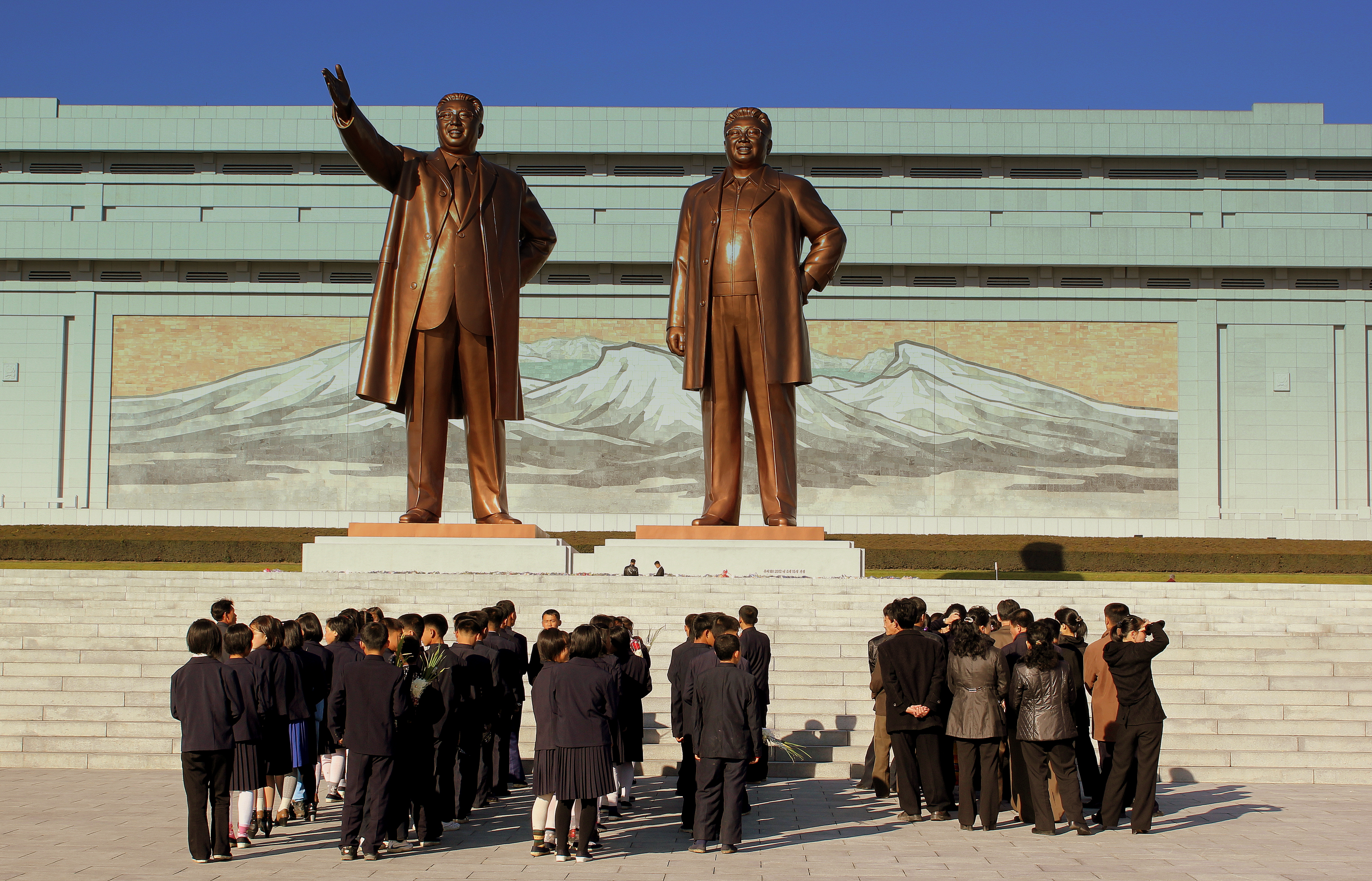 Statues of former leaders Kim Il-sung and Kim Jong-Il in Pyongyang. By flickr user calflier001.