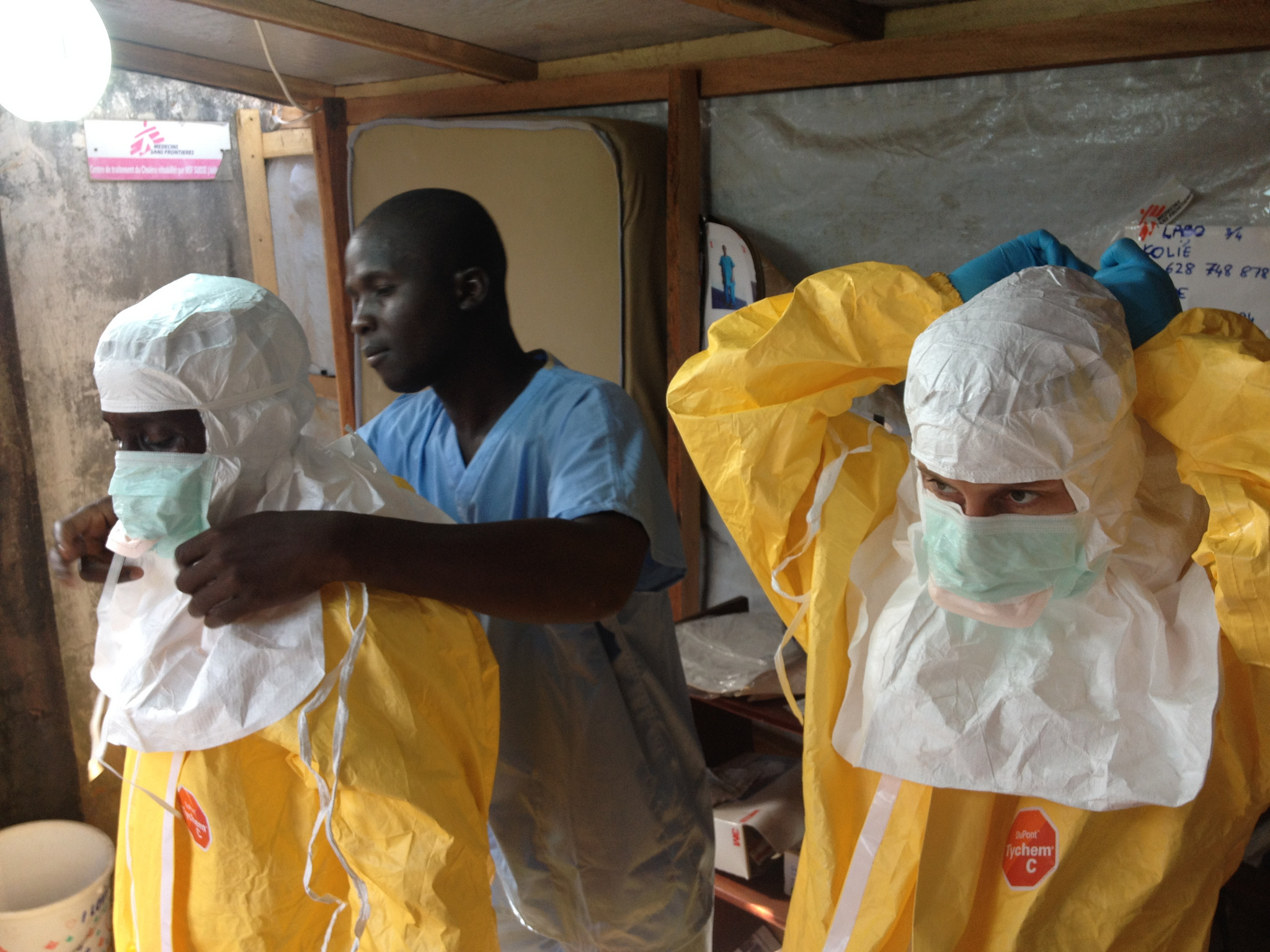 Health care workers in Guinea prepare to treat Ebola patients. By the European Commission DG ECHO.