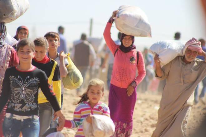 Fleeing ISIS, Syrian Kurds walk into Turkey. By the European Commission DG ECHO.