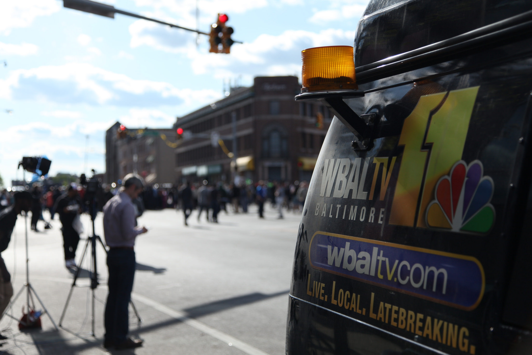 A news van near Baltimore protests over the death of Freddie Gray. By Arash Azizzada.