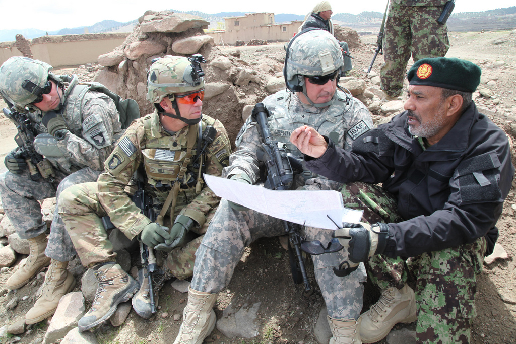 American soldiers speak with a Afghan National Army Commander in Naka, Afghanistan.
