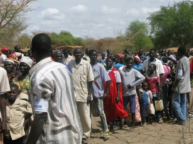 Refugees wait in line for help from UNHCR staff in South Sudan. By DFID.