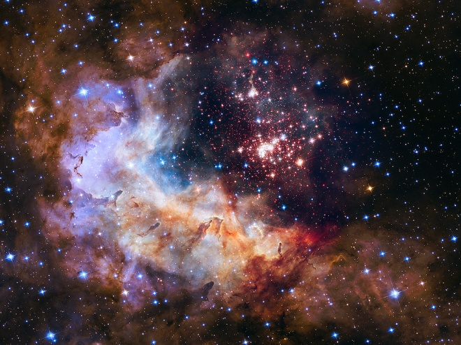 The 25th anniversary NASA Hubble Space Telescope image of a giant cluster of stars, called Westerlund 2, April 23, 2015. By NASA.