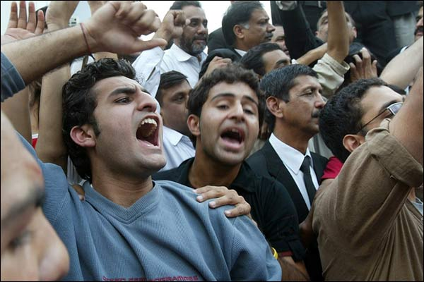 Protestors chanting slogans against Military General and Dictator, Pervaiz Musharraf, November 7, 2007. By Ejaz Asi.