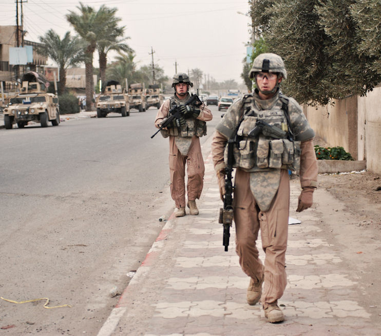 American soldiers perform a walking patrol in Baghdad. By Lachica Photo.