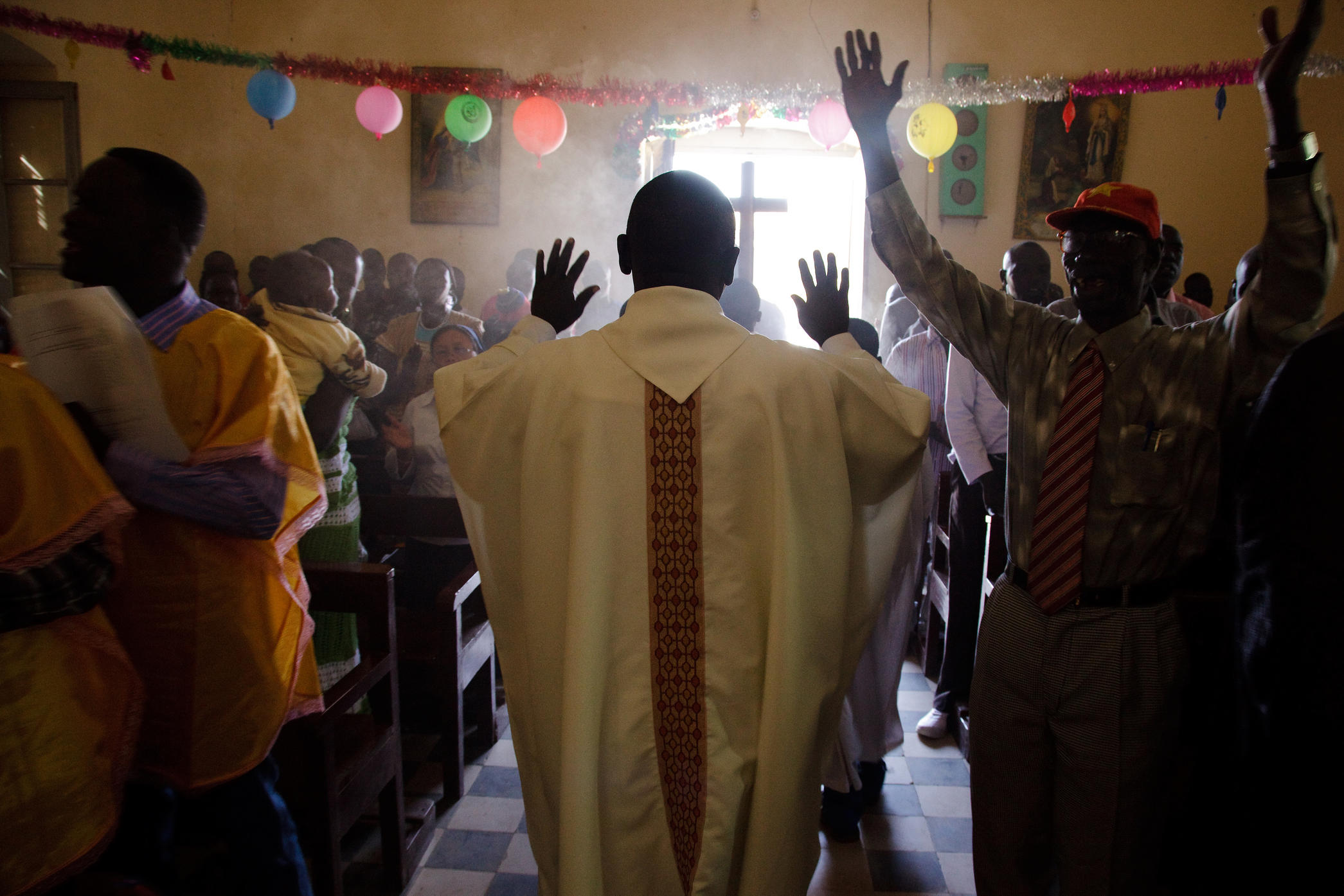South Sudanese Christians celebrate Christmas mass at El Fasher church in North Darfur. Many in their community have recently left Darfur. According to the UN High Commissioner for Refugees (UNHCR), over 55,000 displaced Southern Sudanese have returned home over the past few weeks, ahead of the region's referendum on independence.