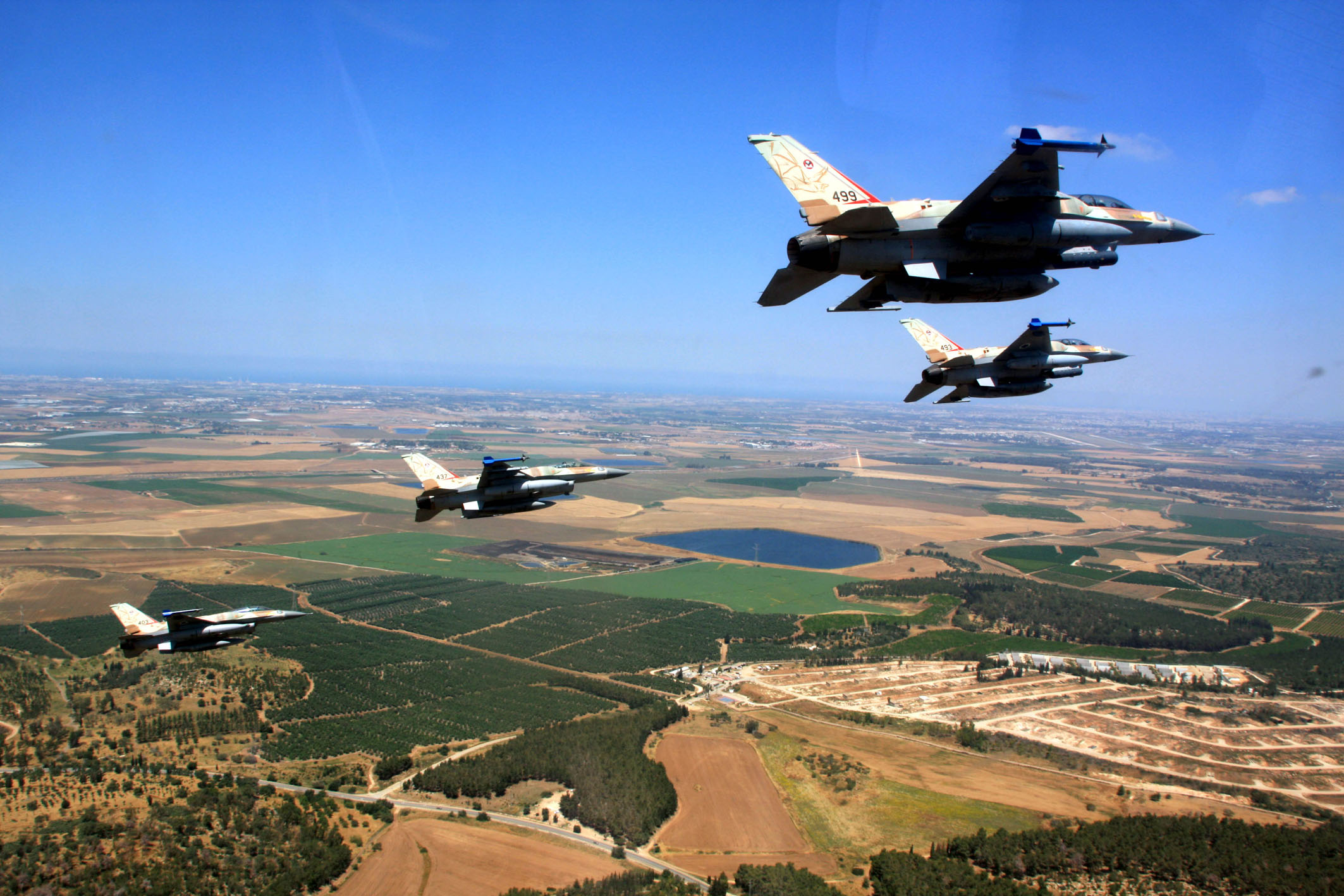 Israeli F-161's fly in formation. By the Israel Defense Forces.
