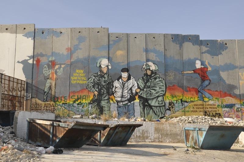Palestinian street art on West Bank Wall. By Wanderlass.