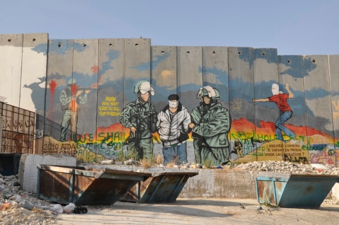 Palestinian street art on West Bank Wall. By Wanderlass.