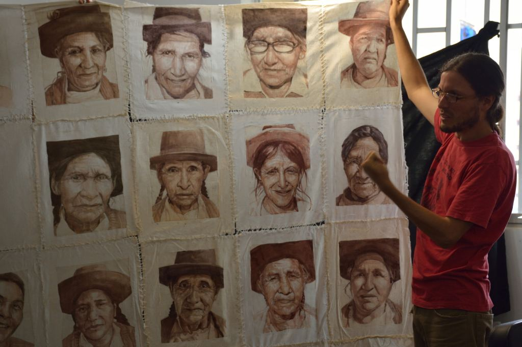 Mauricio Delgado shows a section of his work commemorating efforts by ANFASEP activists who denounced the disappearance of loved-ones during the internal armed conflict in Peru. By Steven T. Zech.