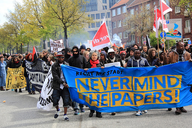 "A Mayday protest in Hamburg, Germany, champions the slogan ""Never Mind the Papers!,"" in solidarity with the inbound refugees from Middle East conflicts, May 1, 2015. By Rasande Tyskar."