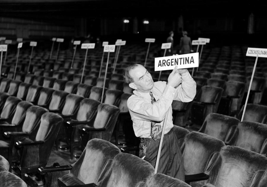 Adding Argentina's sign in the Opera House according to the seating chart, May 19. Delegates of fifty nations met at San Francisco between April 25 and June 26, 1945. Working on the Dumbarton Oaks proposals, the Yalta Agreement, and amendments proposed by various Governments, the Conference agreed upon the Charter of the United Nations and the Statute of the New International Court of Justice. The Charter was passed unanimously and signed by all the representatives. It came into force on October 24, 1945, when China, France, the USSR, the United Kingdom, and the United States and a majority of the other signatories had filed their instruments of ratification. 19/May/1945. San Francisco, United States. UN Photo/McLain. www.unmultimedia.org/photo/