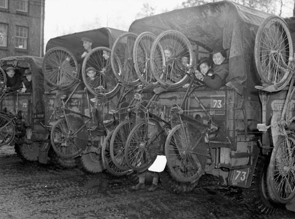 Trucks loaded with refugees and their bicycles, who were evacuated from south of Arnhem, arriving at Nijmegen, Netherlands, November 20, 1944. By Capt. Frank L. Dubervill.