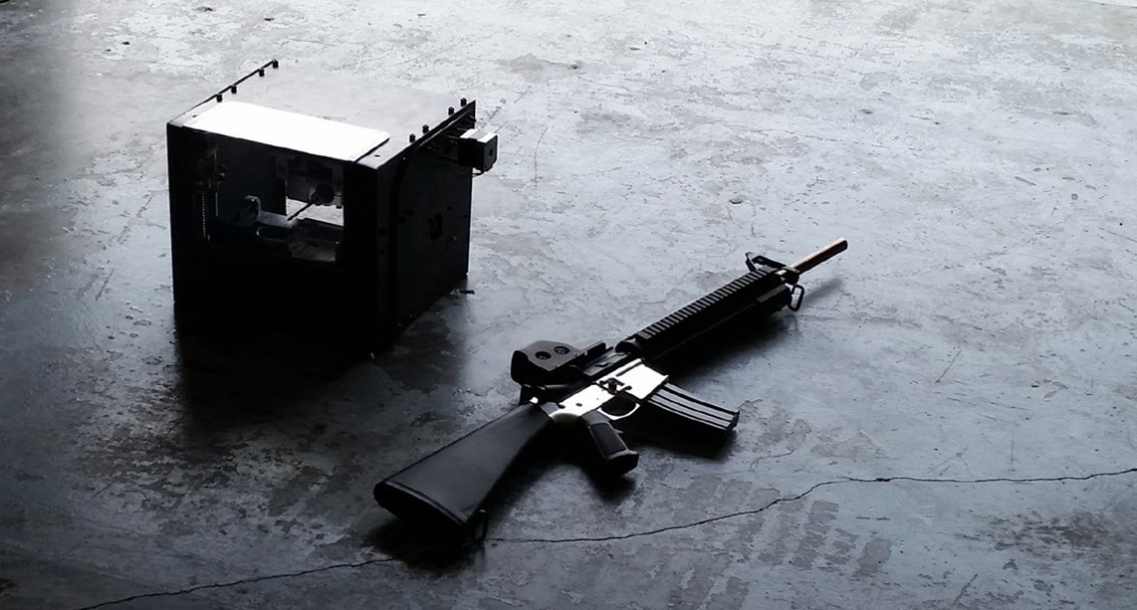 Ghost Gunner CNC machine and AR-15. By Defense Distributed.