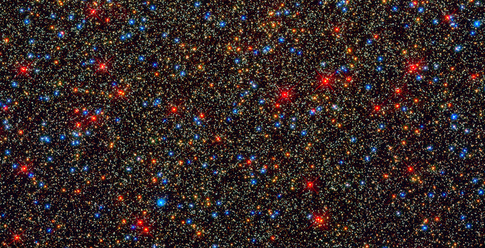 The Omega Centauri, a colorful assortment of 100,000 stars residing in the crowded core of a giant star cluster, between 10 and 12 billion years old. Source: Hubble.