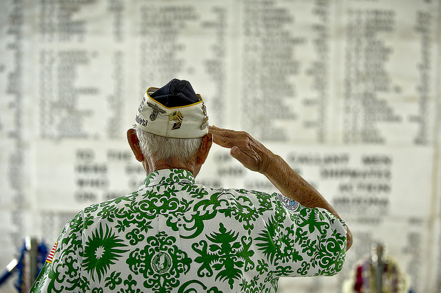 Retired U.S. Army Command Sgt. Maj. Sterling R. Cale, 90-year-old Pearl Harbor survivor, takes a moment in the shrine room of the USS Arizona Memorial to honor the 1,177 service members who lost their lives during the attack on the USS Arizona Dec. 7, 1941. By Technical Sergeant Michael Holzworth.
